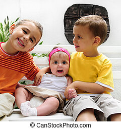 Happy toddlers with baby girl - Portrait of two caucasian ...