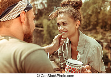 Delighted young woman smiling to her boyfriend