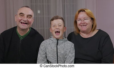 Happy toothless grandfather, granny and grandson together ...