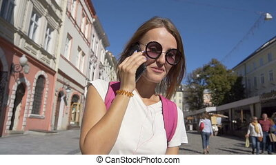 Happy Tourist Girl Talking on the Phone