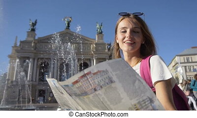 Happy Tourist Girl Watching Map in Fountain