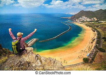 happy tourist man near Playa de Las Teresitas