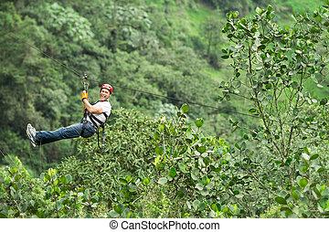 Adult Man On Zip Line Ecuadorian Andes High Altitude