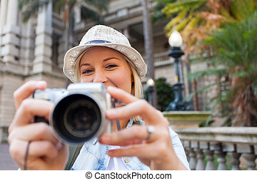 tourist taking photos in the city - happy tourist taking...