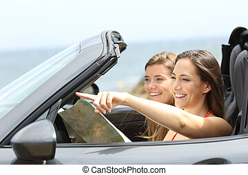 Happy tourists in a car consulting guide on vacations