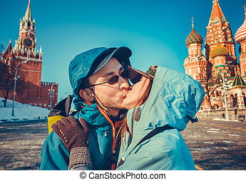 Happy tourists kissing on Red Square, Moscow