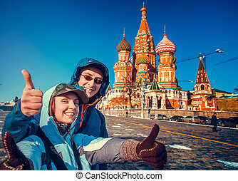 Happy tourists on Red Square, Moscow, Russia