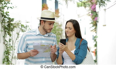 Happy tourists walking checking phone content on vacation