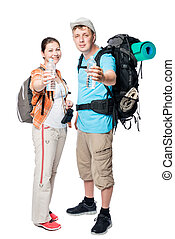 happy tourists with bottles of water on a white background