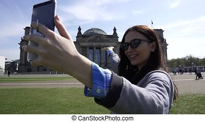 Happy Travel Woman Making Video Call On Smartphone, Reichstag Building, Berlin