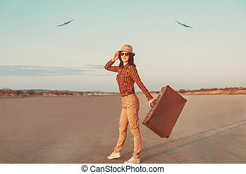 Happy traveler - Happy woman traveler with suitcase walking...