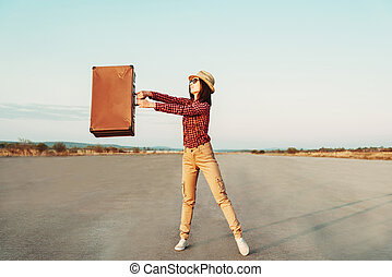 Happy traveler with suitcase
