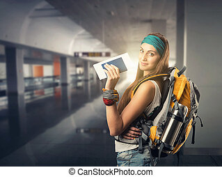 Happy traveler woman is waiting for a flight