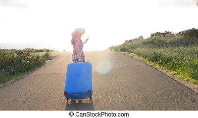 Happy traveler woman running with suitcase