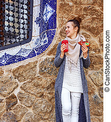 happy traveller woman at Guell Park at Christmas looking...