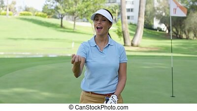 Happy triumphant golfer tossing the ball - Happy triumphant...
