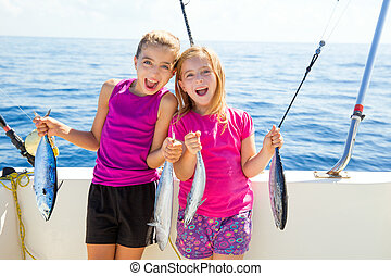 Happy tuna fisherwomen kid girls with fishes catch - Happy...
