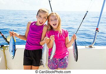Happy tuna fisherwomen kid girls with fishes catch - Happy...