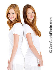 twin teen girls - happy twin teen girls back to back