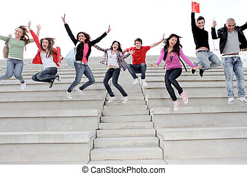 Teens; teenagers; people; kids; youth; young; adults; fun; happy; group; friends; boys; girls; men; women; outdoors; Boy ,university ,student ,latin, smiling ,diverse, diversity, campus, american, caucassian, spanish, asian, mixed, race, multi, books, jumping shouting, smiling, class, campus,
