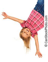 Happy upside down - Happy 4 years old girl hanging upside...