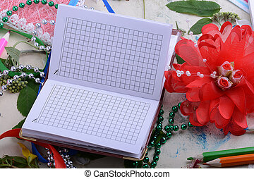 Happy Valentine Day card with paper note book on table. Red hearts, flower, gift, pencil on table
