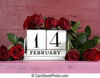 Happy Valentine Day vintage wood calendar for February 14 on red and pink vintage wood background with bouquet of red roses.