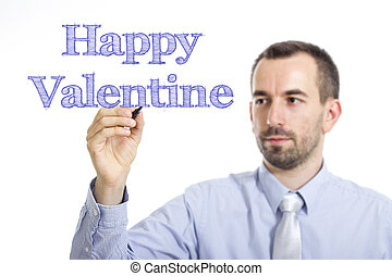 Happy Valentine - Young businessman writing blue text on transparent surface