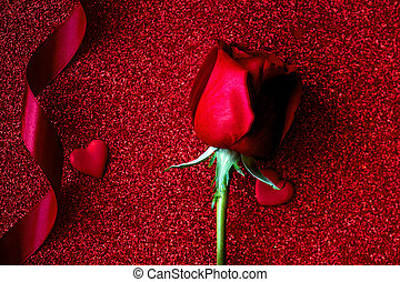 Happy Valentines day Background with roses, ribbon, bow and hearts on glittering red paper with copyspace. Love concept. Flat lay