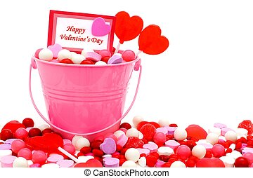 Happy Valentines Day card in a pink pail with candies over white