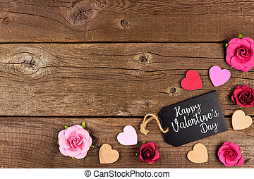 Happy Valentines Day corner border with gift tag, hearts and roses against rustic wood