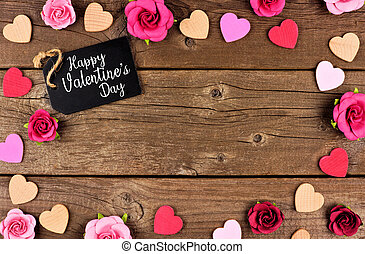 Happy Valentines Day frame with gift tag, hearts and roses against rustic wood
