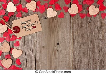 Happy Valentines Day gift tag with scattered wooden hearts and confetti corner border on a rustic wood background