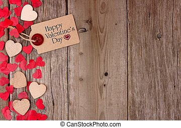 Happy Valentines Day gift tag with scattered wooden hearts and confetti side border on a rustic wood background