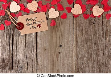 Happy Valentines Day gift tag with scattered wooden hearts and confetti top border on a rustic wood background