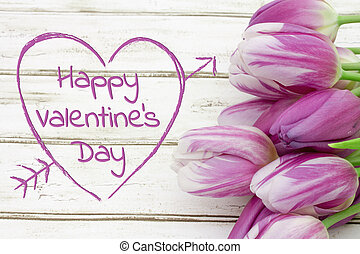 Happy Valentine's Day greeting with tulips on weathered wood