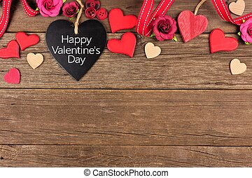 Happy Valentines Day heart shaped chalkboard tag with border against rustic wood