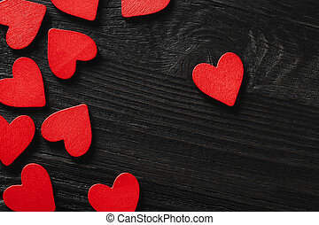 Happy Valentine's day hearts on wooden background.