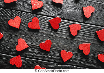 Happy Valentine's day hearts on wooden background
