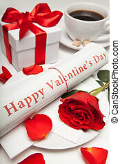 """""""happy valentine's day"""" newspaper, red rose and present"""