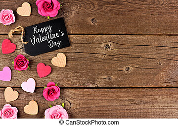 Happy Valentines Day side border with gift tag, hearts and roses against rustic wood