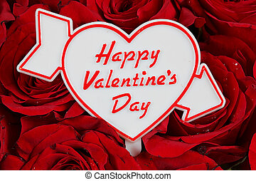 Happy Valentines Day sign on red roses