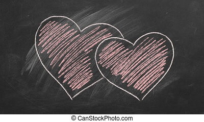Two hearts are hand drawn with chalk on a blackboard. Valentines day. Love concept. I Love You