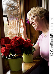 happy visit - elderly woman is waving and happy with visit