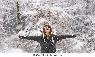 Happy vivacious woman celebrating the snow - Happy vivacious...