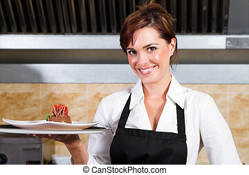 happy waitress holding plate of dessert