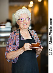 Happy Waitress With Coffee Cup In Cafeteria