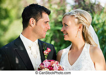 Happy wedding couple - wedding couple looking at each other,...