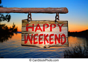 Happy weekend motivational phrase sign on old wood with ...