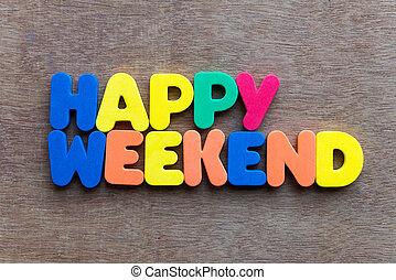 happy weekend words in wood background
